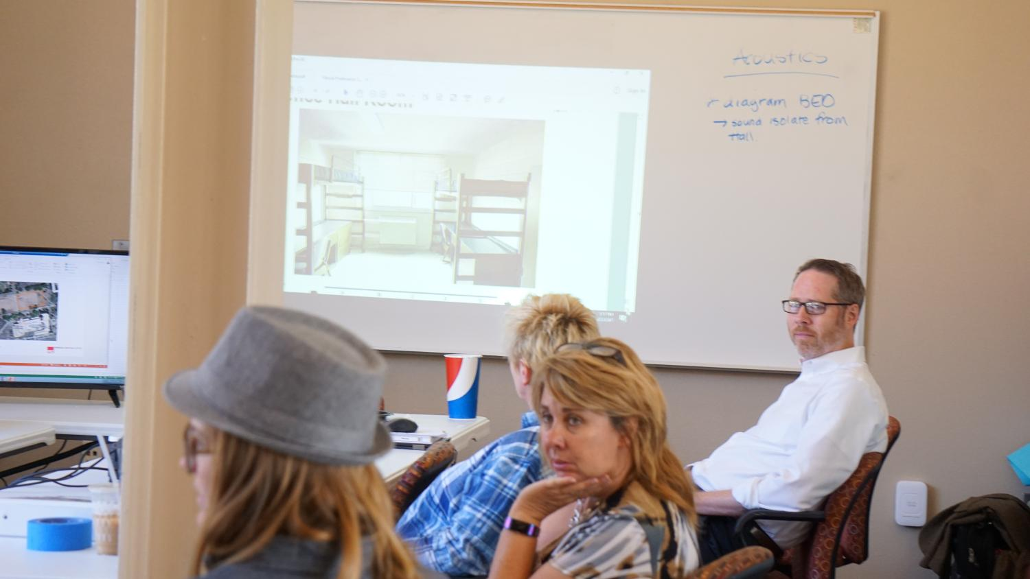Discussions over the new suite-style residence hall that will be built on the old Monagle Hall site.