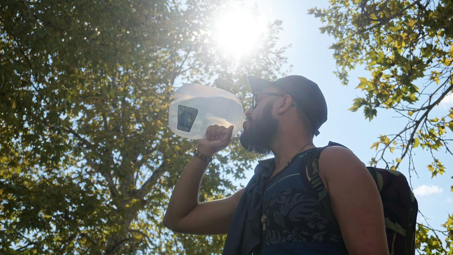 NMSU student trying to stay hydrated in these high tempuratures while walking to class.