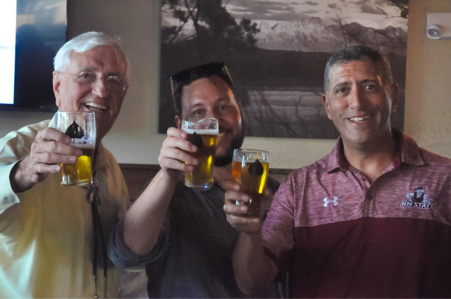 NMSU President Garrey Carruthers (Left), Bosque Managing Director Gabe Jensen, and Athletic Director Mario Moccia pose on Thursday as the University announced a partnership that includes their own, branded, beer.