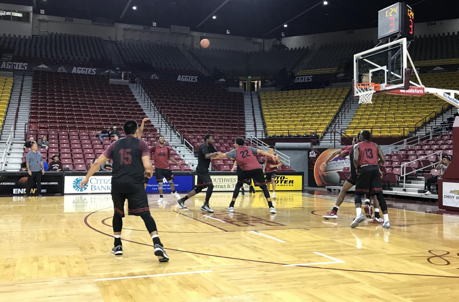 Team black puts up a shot during Saturday's intrasquad scrimmage at the Pan Am.