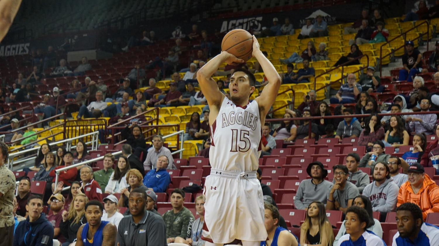 Senior guard Joe Garza goes up for a shot during Wednesday night's exhibition game. NMSU won 90-83.