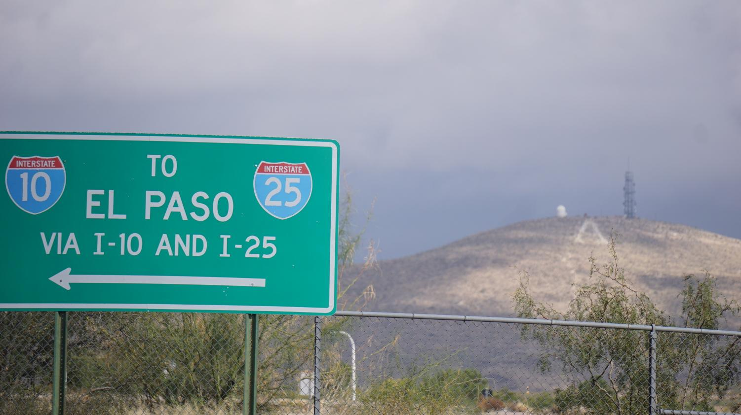A traffic sign with directions to El Paso near the edge of the campus.