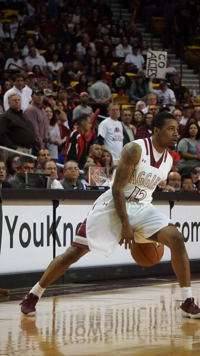 AJ Harris looks to make a play as the Aggies defeated their out of state rival 72-63.