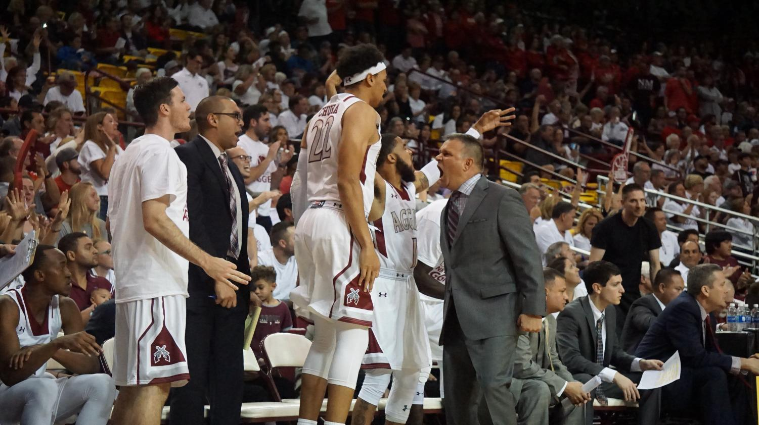 Head Coach Chris Jans hyping the bench after an Aggie score.