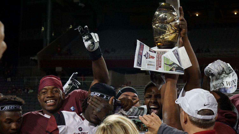 Aggies celebrate the Arizona Bowl Victory.