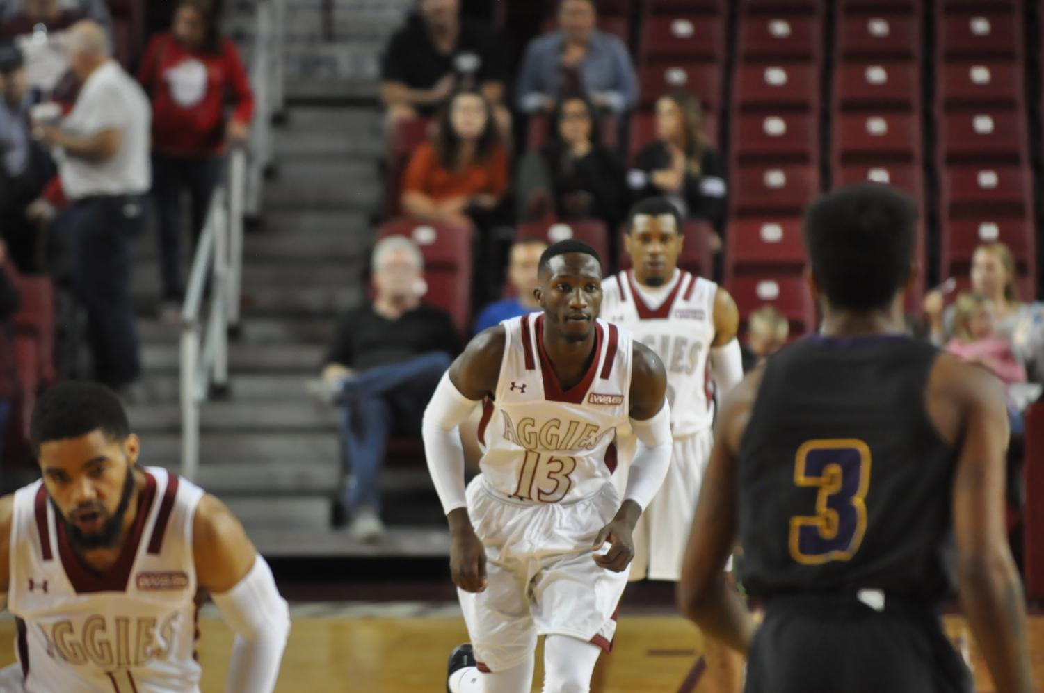 NMSU junior guard Sidy N'Dir looks to play some defense Sunday evening in the Pan American Center. The Aggies Defeated the Panthers 69-57 and improved to 6-1.