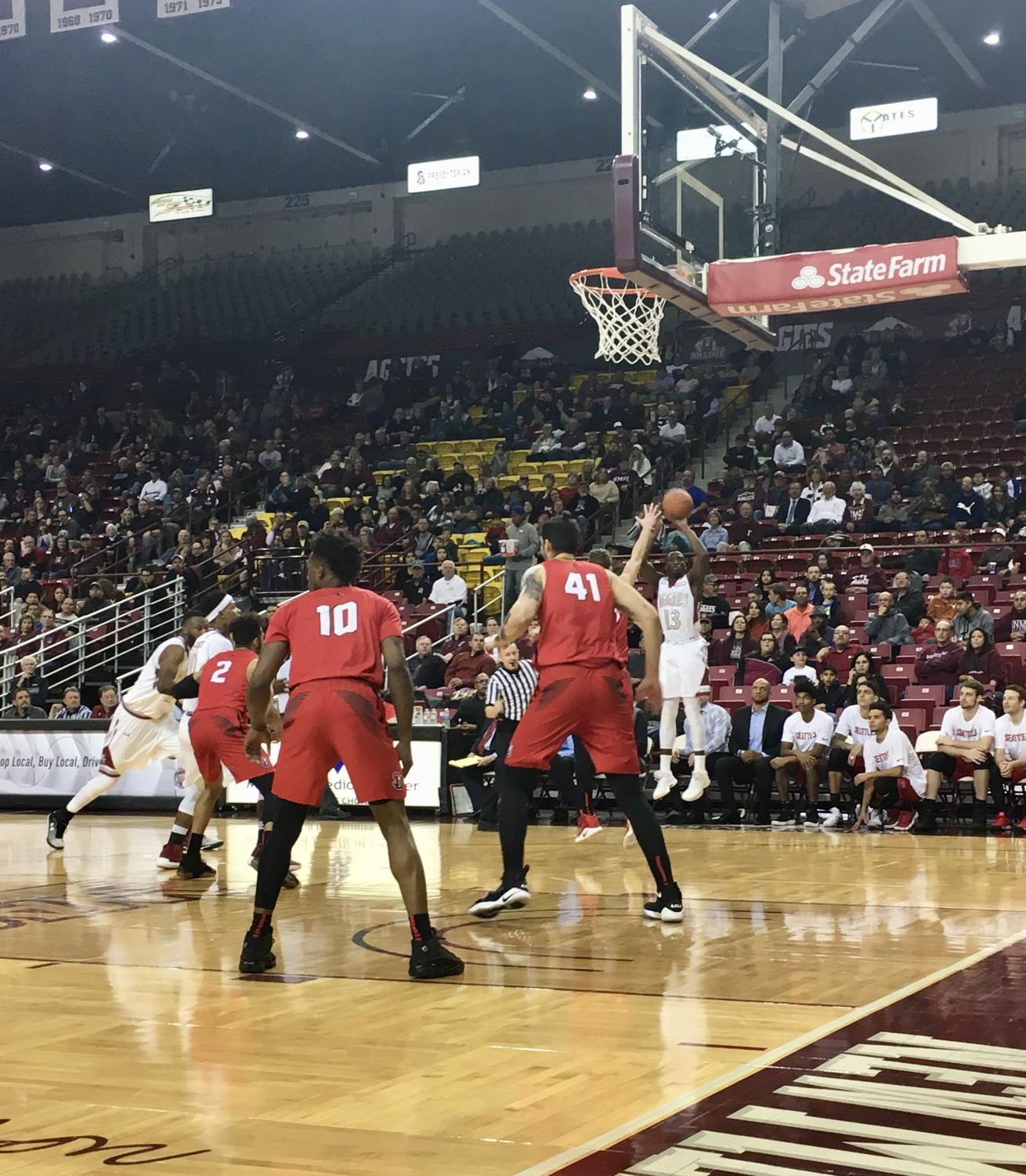 Redshirt junior guard Sidy N'Dir puts up a three-point shot as the Aggies grabbed the victory and remained undefeated in WAC play.