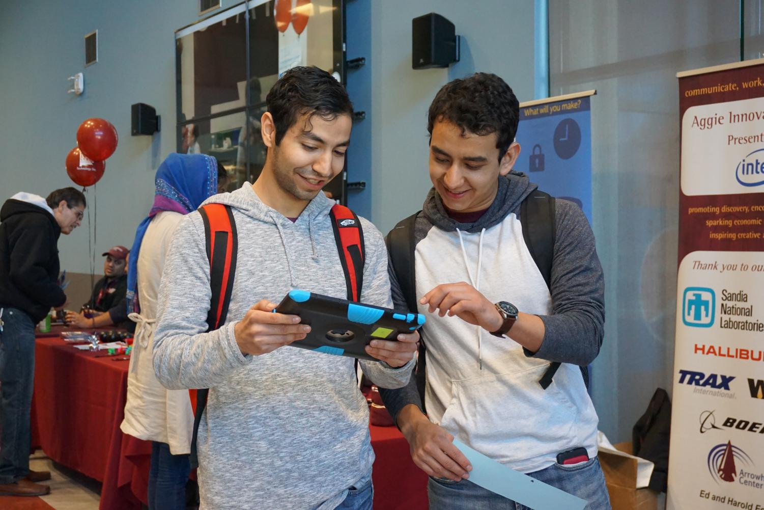 Students interact with new technology inside NMSU's Aggie Lounge on Tech Day.
