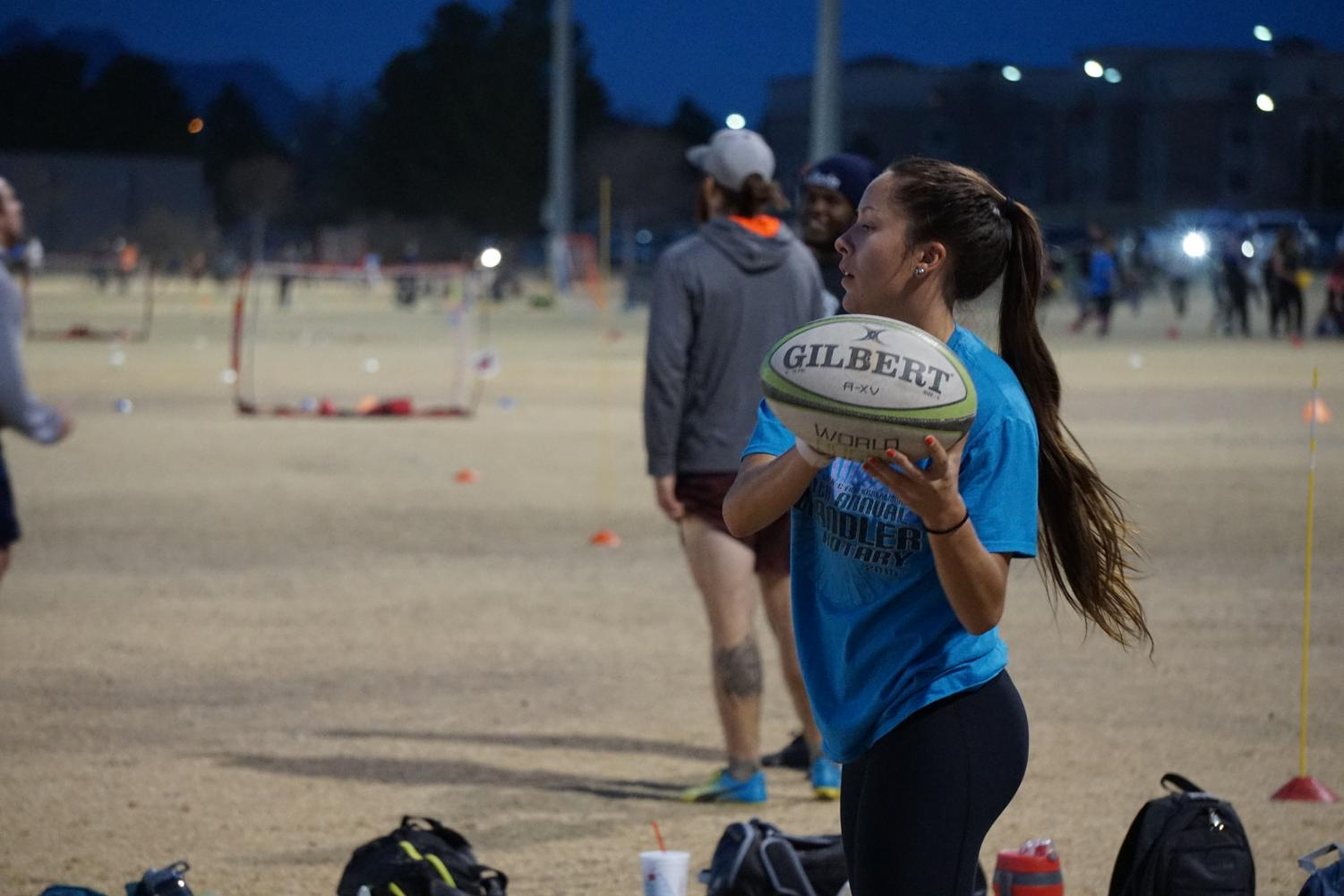 NMSU rugby players warm up before practice.