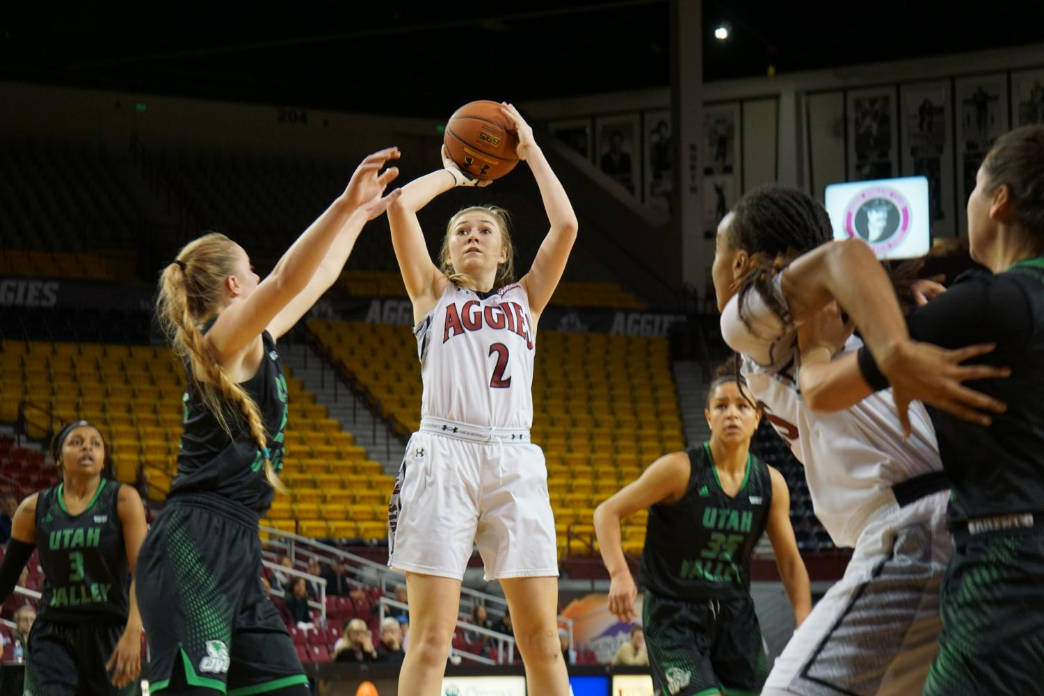 Brooke Salas sinks a shot surrounded by the Utah Valley defense