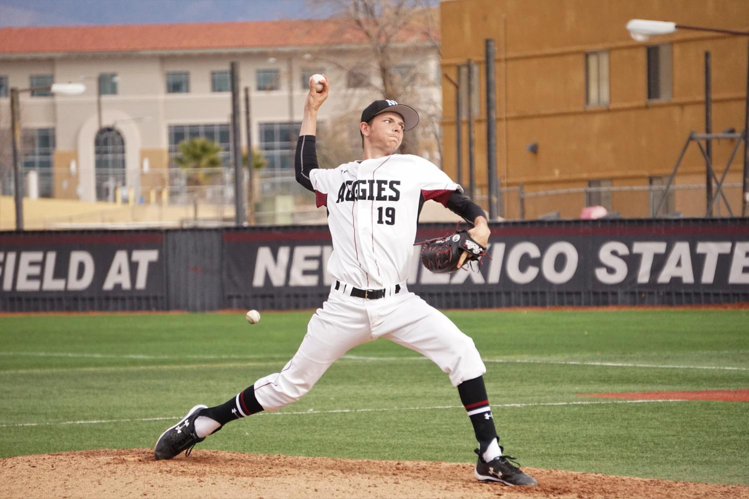 NMSU sophomore Chance Hroch delivers a pitch to the plate as the Aggies won both games during Saturday's doubleheader.