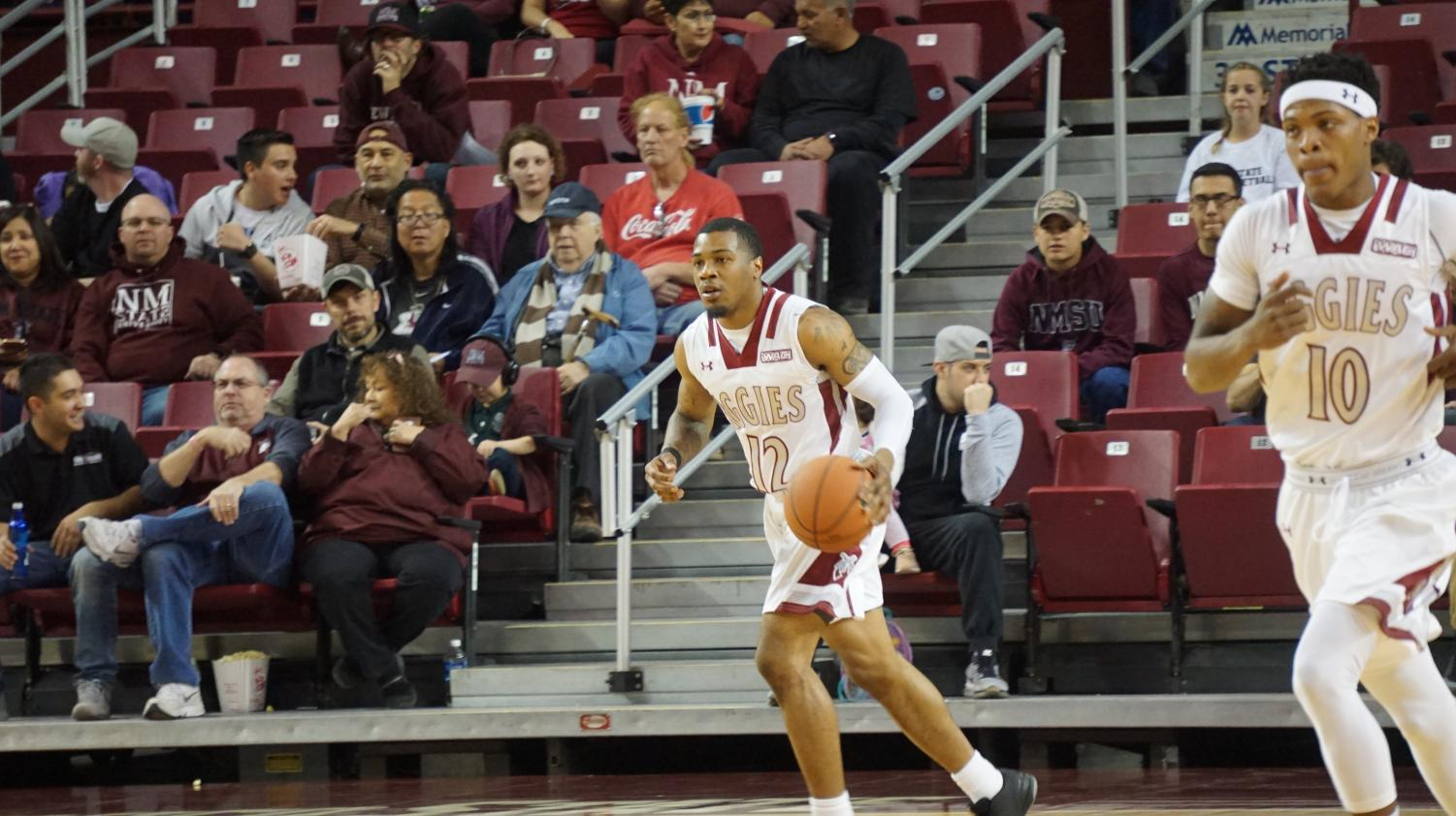 NMSU's AJ Harris and Jemerrio Jones look to move the ball up court Thursday night in a blow out win against CSUB.