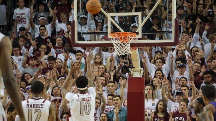 NMSU%27s+Jemerrio+Jones+shoots+a+pair+of+free-throws+in+front+of+a+sold+out+Pan+American+Center+crowd.+Students+are+seen+%22putting+their+guns+up%22+in+hopes+of+a+made+free-throw.+Jones+has+been+on+a+tear+recently%3B+having+another+20+rebound+game.+