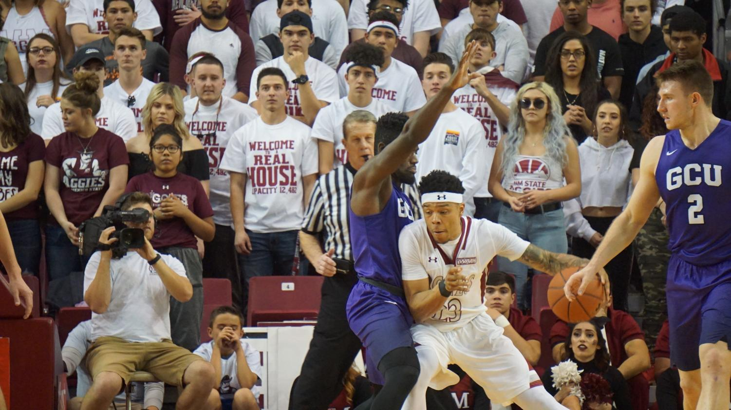 NMSU's Zach Lofton muscles his way to the basket on Saturday night in front of a sold out crowd.