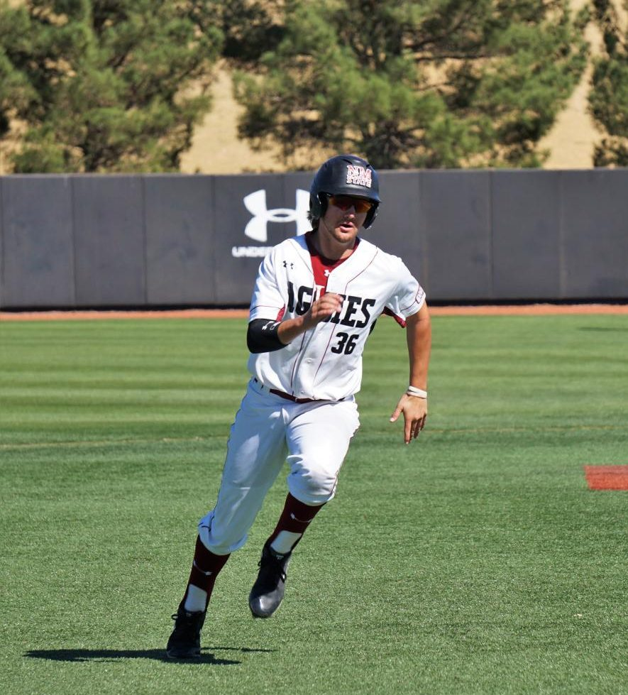 NMSU's Logan Ehnes looks to round third during Saturday's loss against Sacramento State.
