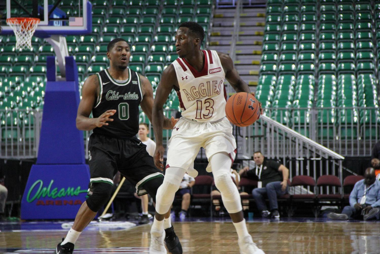 Sidy N'Dir moves the ball up the court Thursday night inside the Orleans Arena in Las Vegas, Nevada. NMSU will move on to the semifinals in the WAC tournament.