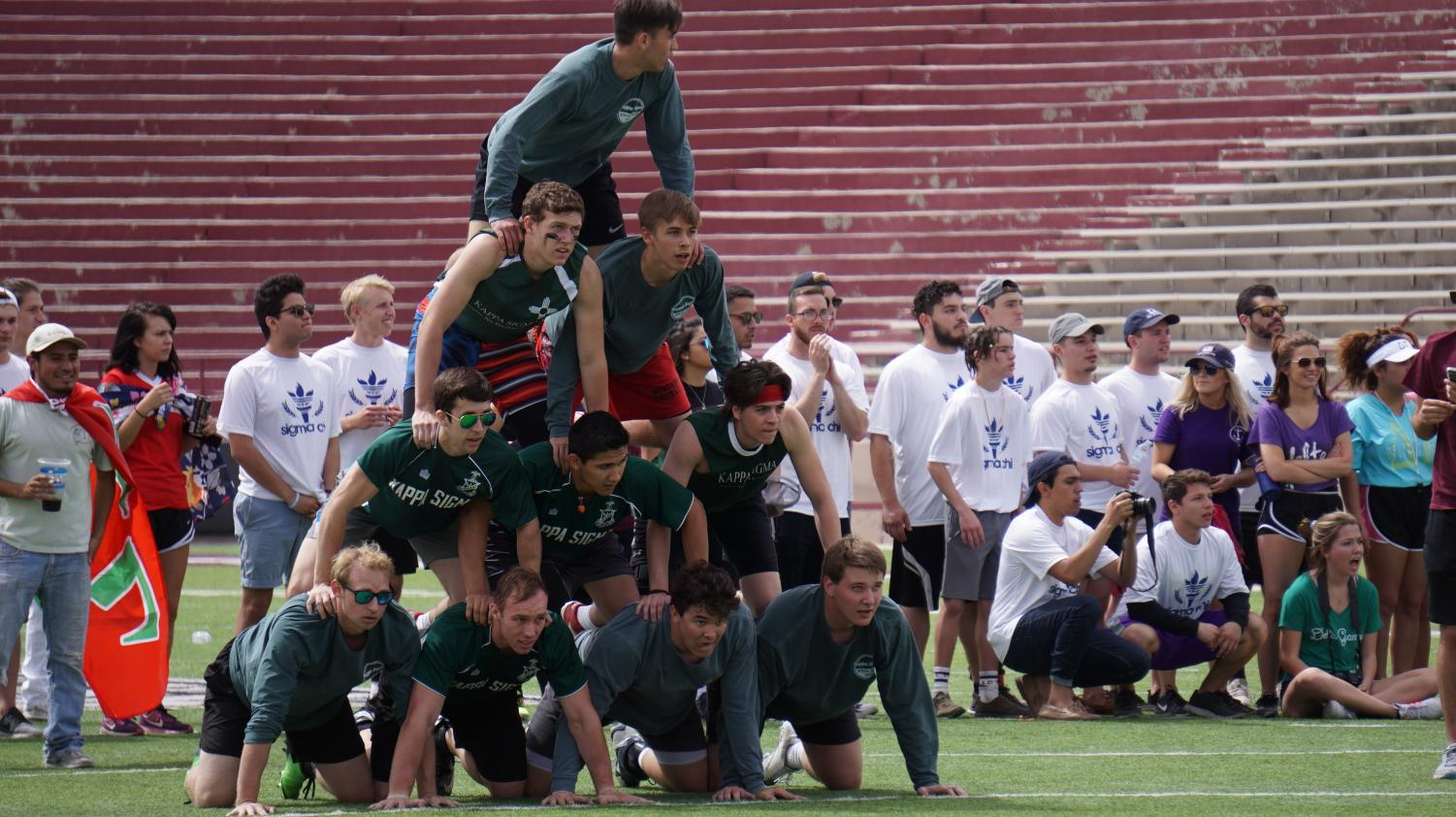 Kappa Sigma holding together their pyramid.