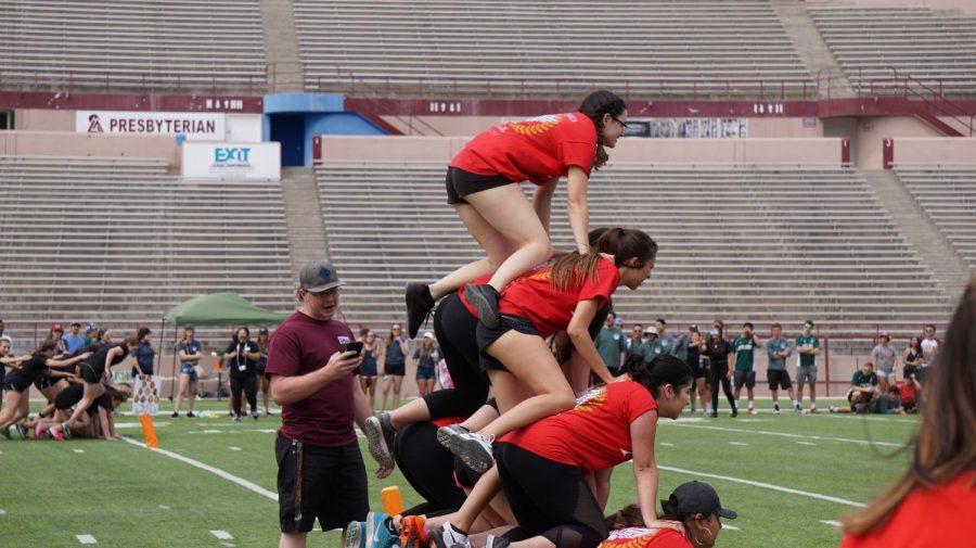 Chi Omega constructing a human pyramid.