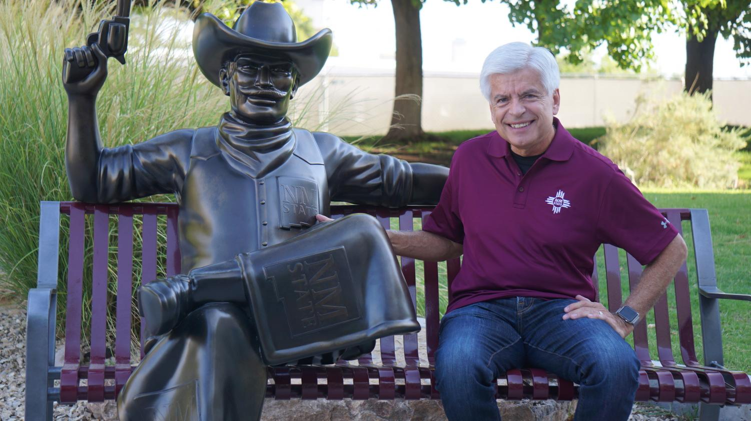 Chancellor Arvizu poses with the new Pistol Pete bronze sculpture outside Corbett Center during its unveiling Wednesday morning.