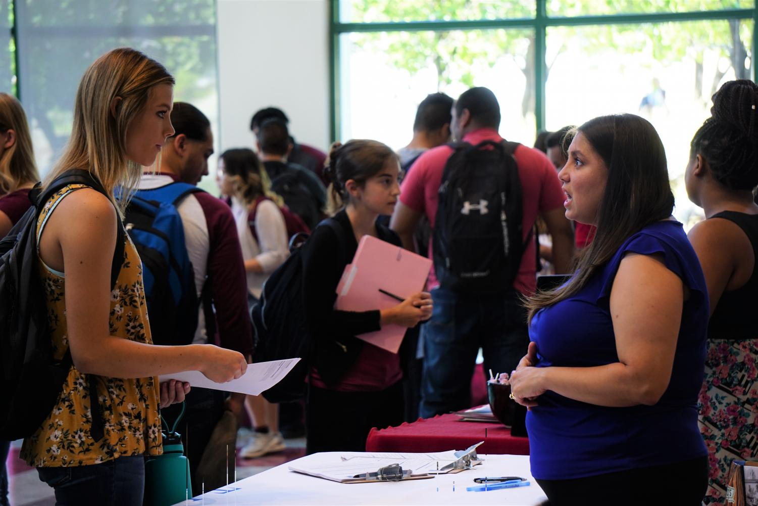 Students talk with recruiters from businesses and organizations  looking to hire NMSU students.