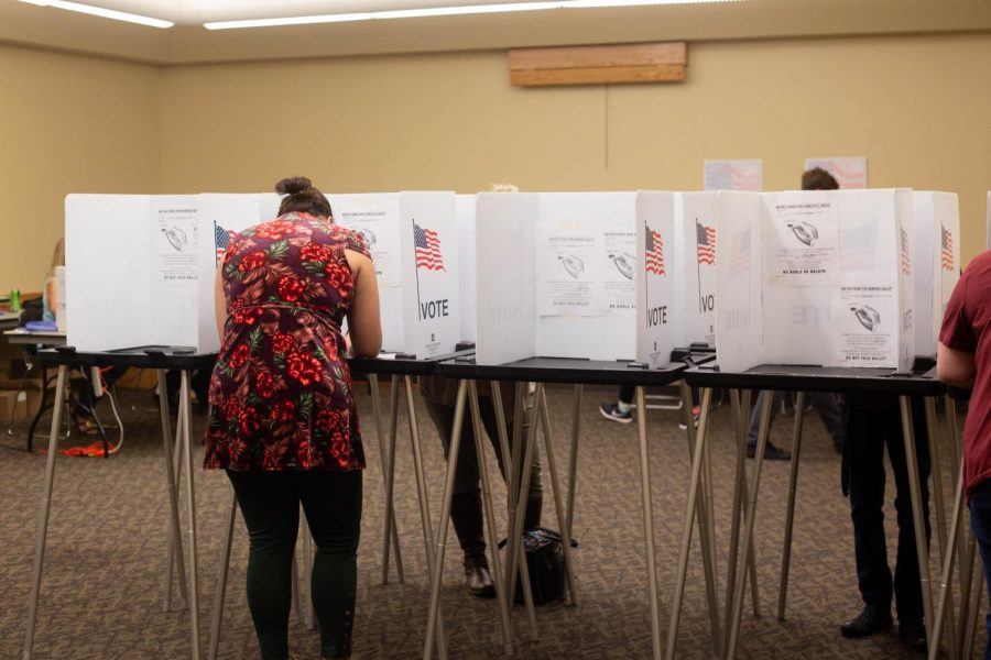 A woman votes at a polling booth set up in New Mexico State University.