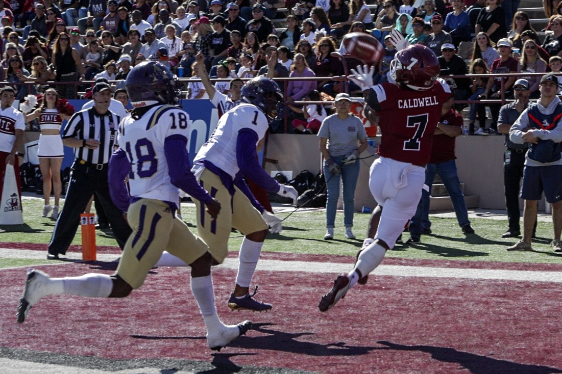 Royce Caldwell snags a corner-of-the-end zone touchdown in the first quarter of his final game at Aggie Memorial.