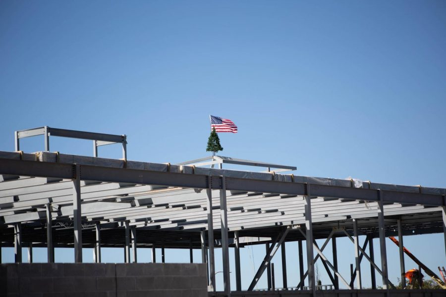 The+American+flag+and+Christmas+tree+can+by+seen+by+NMSU+students+and+folks+driving+on+University+Ave.+