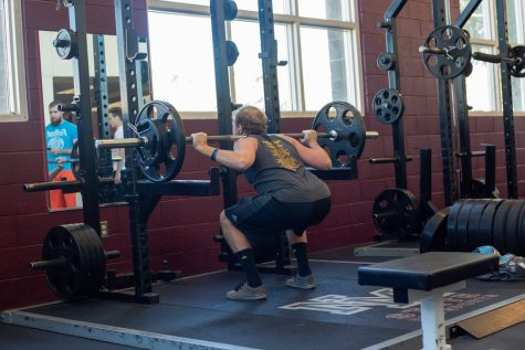 An athlete performs squats in the NMSU Recreational Activities Center on January 28, 2019.