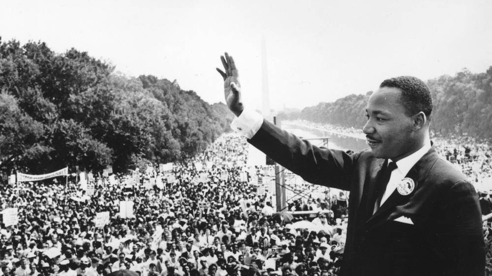 Dr. Martin Luther King  Jr. acknowledges crowd after his famous