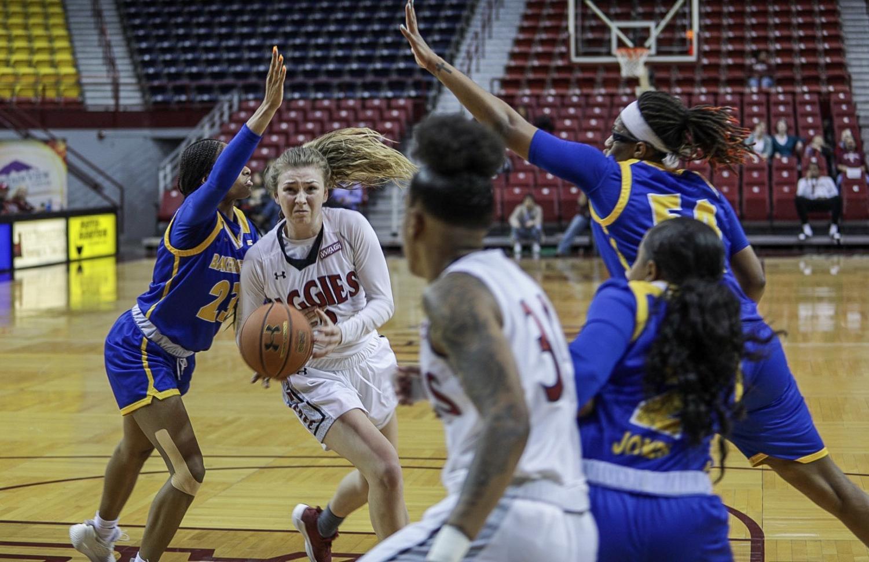 Brooke Salas looks for Gia Pack through a warming CSUB defense.
