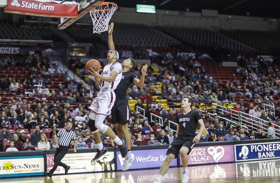 Trevelin Queen finishes an acrobatic reverse layup in the first half of NM State's lopsided win over the Dustdevils.