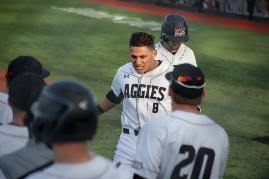 Joey+Ortiz+celebrates+his+first-inning+homer+in+NM+State%27s+dominant+season-opening+victory+over+Texas+State.