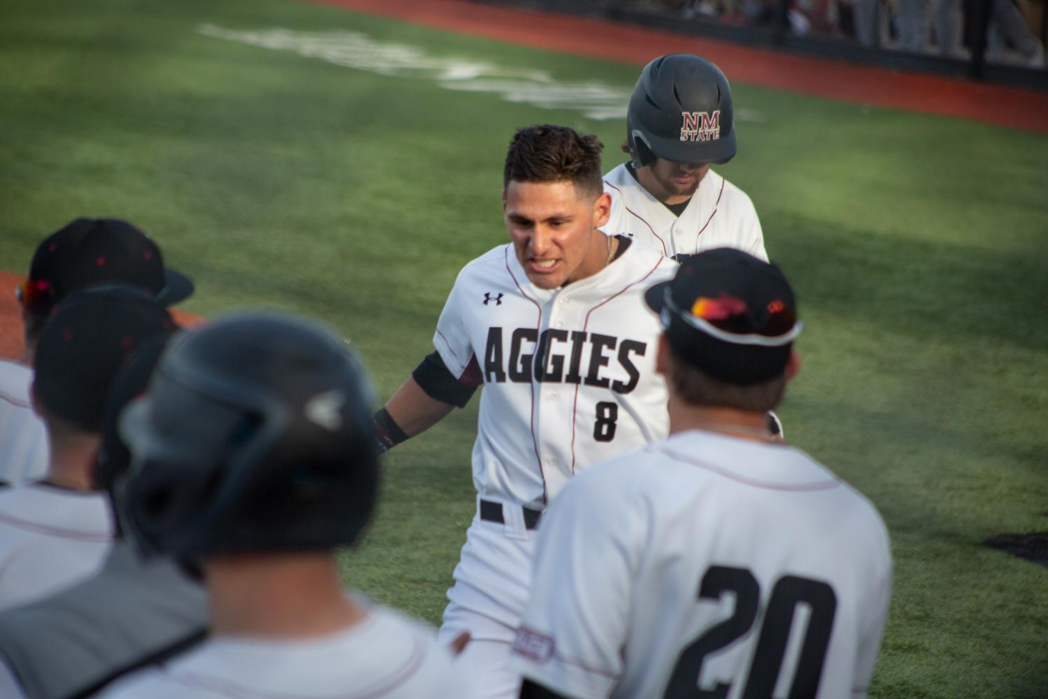 Joey Ortiz celebrates his first-inning homer in NM State's dominant season-opening victory over Texas State.
