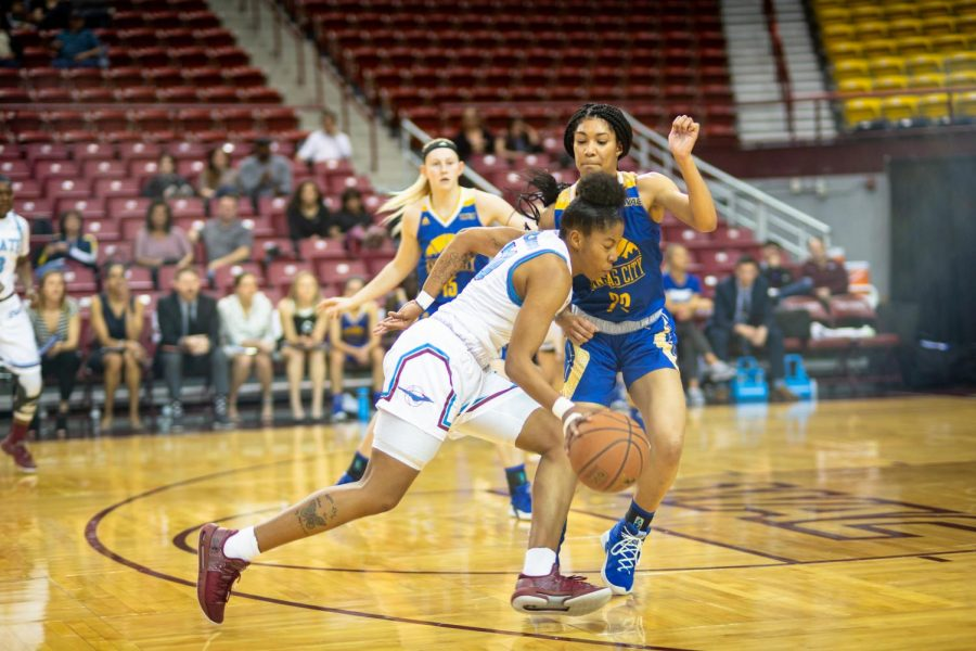 Gia+Pack+drives+past+UMKC+on+her+way+to+a+near+triple+double+performance+%2818+points%2C+12+rebounds+and+seven+assists%29.