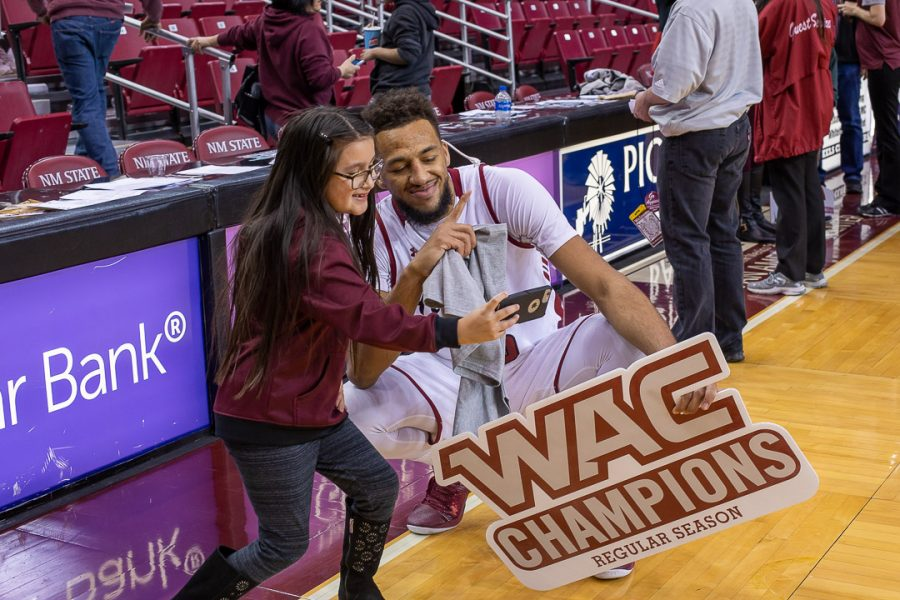 Hometown+product+Johnny+McCants+poses+with+a+fan+following+the+Aggies%27+regular+season+conference+championship.