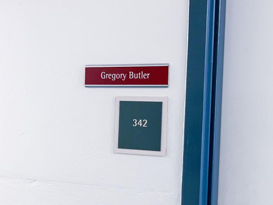 Government Professor Gregory Butler's office door in Breland Hall.