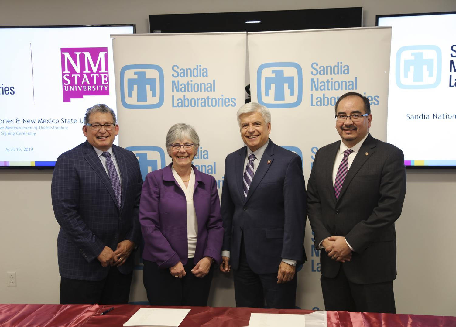 New Mexico State University and Sandia National Laboratories signed a 10-year memorandum of understanding April 10 in Albuquerque. From left, Jaime Moya, director of environment, safety and health, Sandia National Laboratories; Susan Seestrom, associate labs director and chief research officer, Sandia National Laboratories; Dan Arvizu, NMSU chancellor; and Dan Sanchez, technology partnerships program manager, National Nuclear Security Administration Sandia Field Office; attend the signing ceremony. (Courtesy photo by Lonnie Anderson)