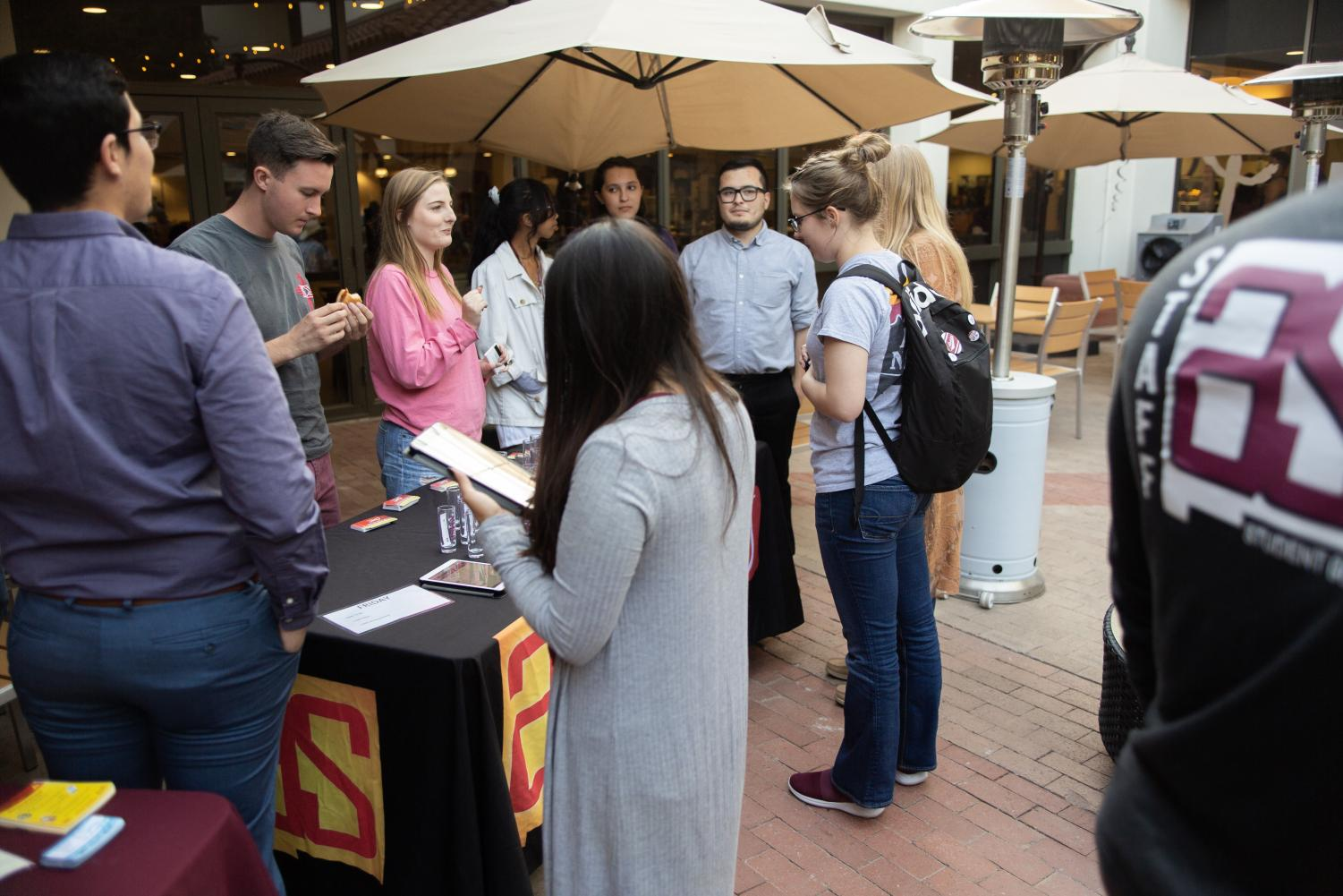 Students stand in line waiting to vote for ASNMSU senate positions  at Pete's Patio Oct. 25