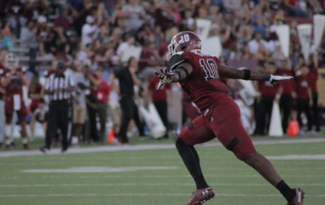 Cedric Wilcots celebrates a sack against Liberty.