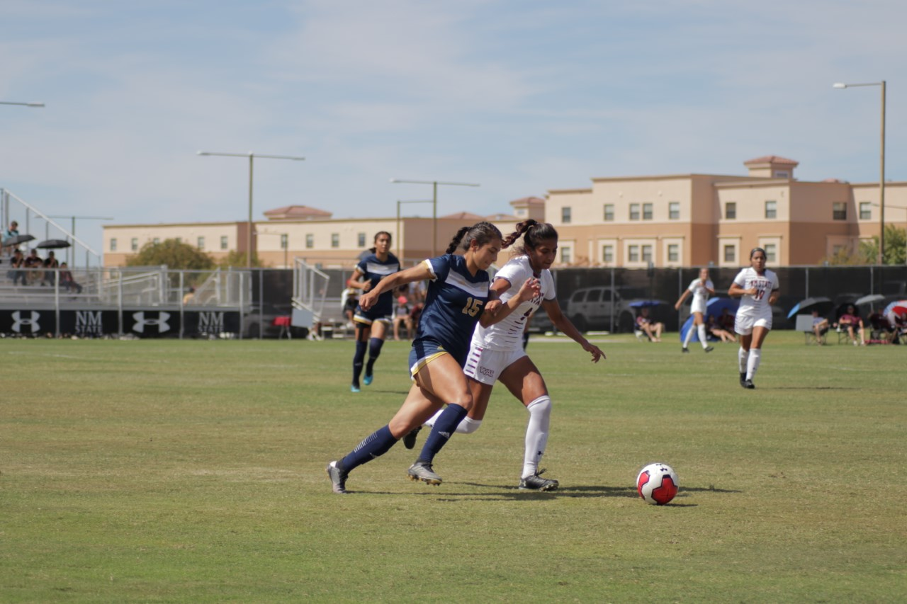 Alexa Barrera jostles with the CBU defender for possession.