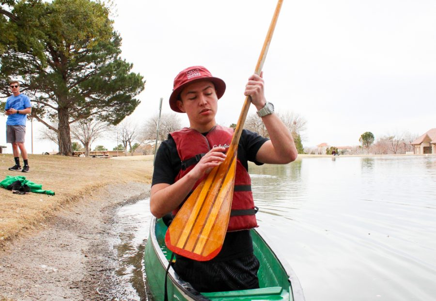A team member getting ready to start canoeing on the duck pond.