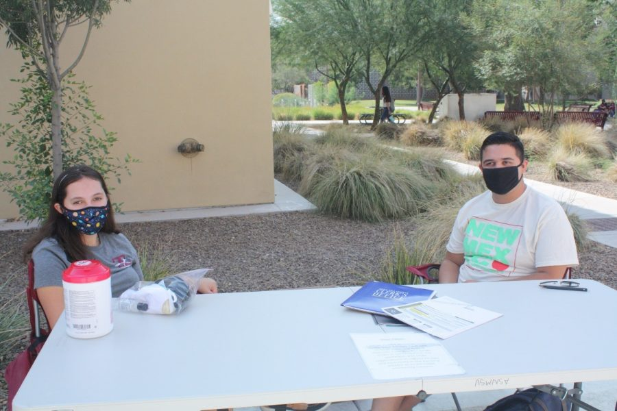 Two+students+from+ASNMSU+tabled+near+the+Business+Complex++on+Sept.+22+to+talk+to+students+about+registering+to+vote.+