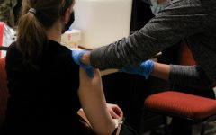 A woman receives a COVID-19 Vaccination at the Las Cruces Convention Center Jan. 27, 2020.