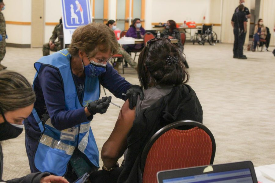 A woman gets her COVID-19 vaccination