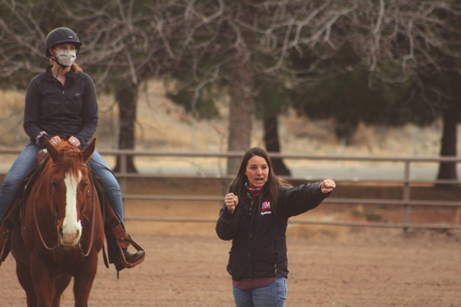 NMSU's Equestrian team coach Hannah Swarthout teaches her riders a few things before practice.