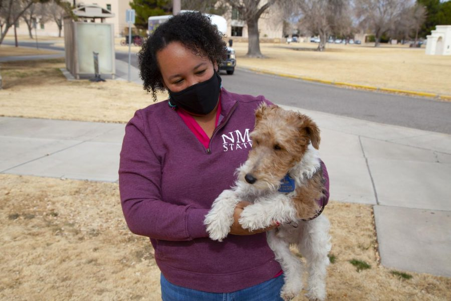Angela Owens, newly hired director of Glass Family Research Institute for Early Childhood Studies, holds Samson the dog, associated with Guide Dogs for the Blind NMSU Community Puppy Raisers