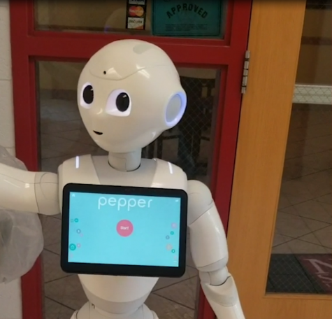 NMSU Robot Pepper interacts with patrons heading into the 100 West Cafe at NMSU. (Courtesy Andrea Arrigucci)