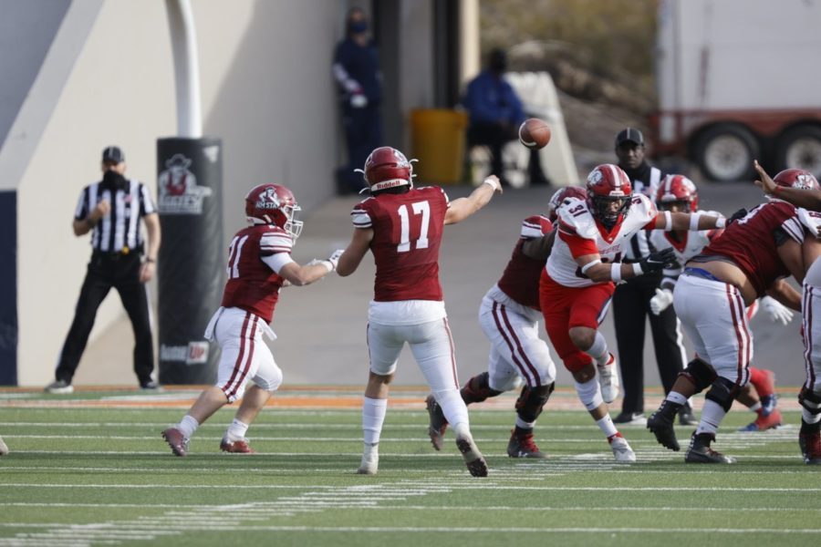 Weston Eget completes six of eight passes for 61 yards and a score in his short stint at quarterback before leaving the game with a foot injury. (Photo courtesy of NMSU Athletics)