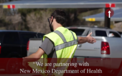 A volunteer directs traffic at the NMSU vaccination center on Friday, March 5, 2021.