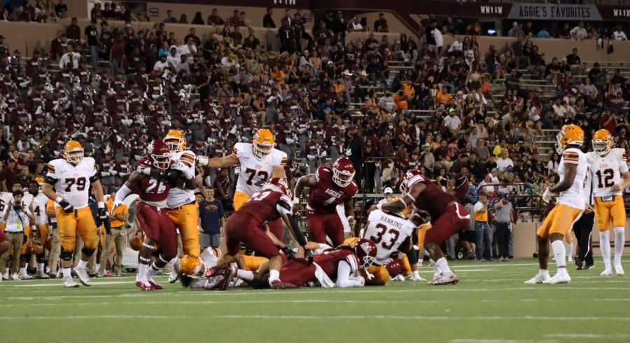 UTEP+Runningback+D.+Hankins+wrapped+up+by+the+Aggie+defense